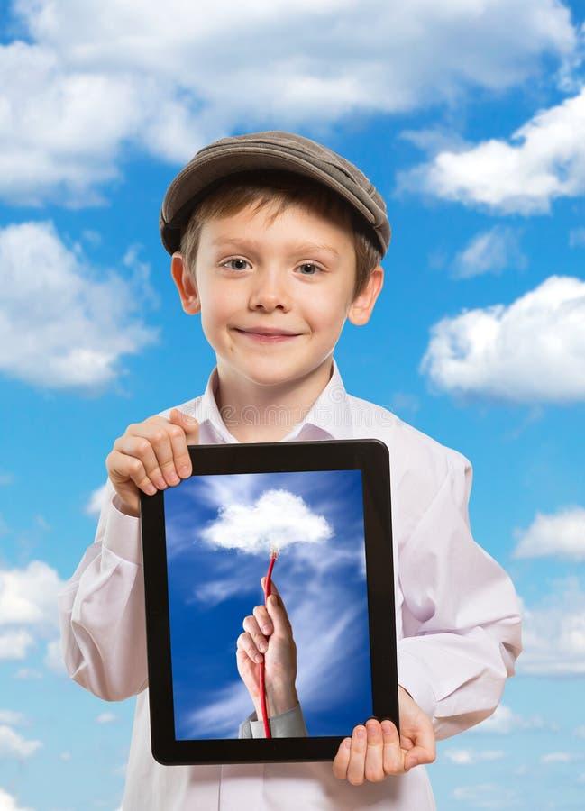Dziecko używa pastylka peceta obrazy stock