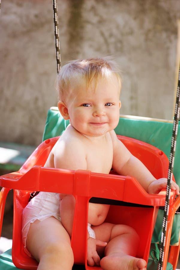 Dziecko w huśtawce obraz stock