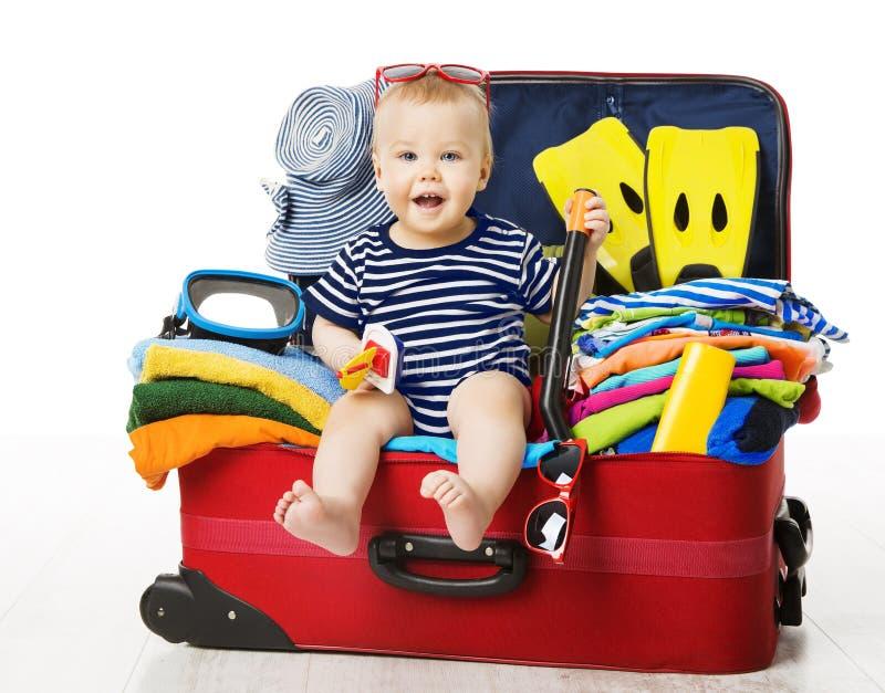Dziecko w podróży walizce, dzieciaka obsiadania wakacje bagaż, dziecko fotografia royalty free