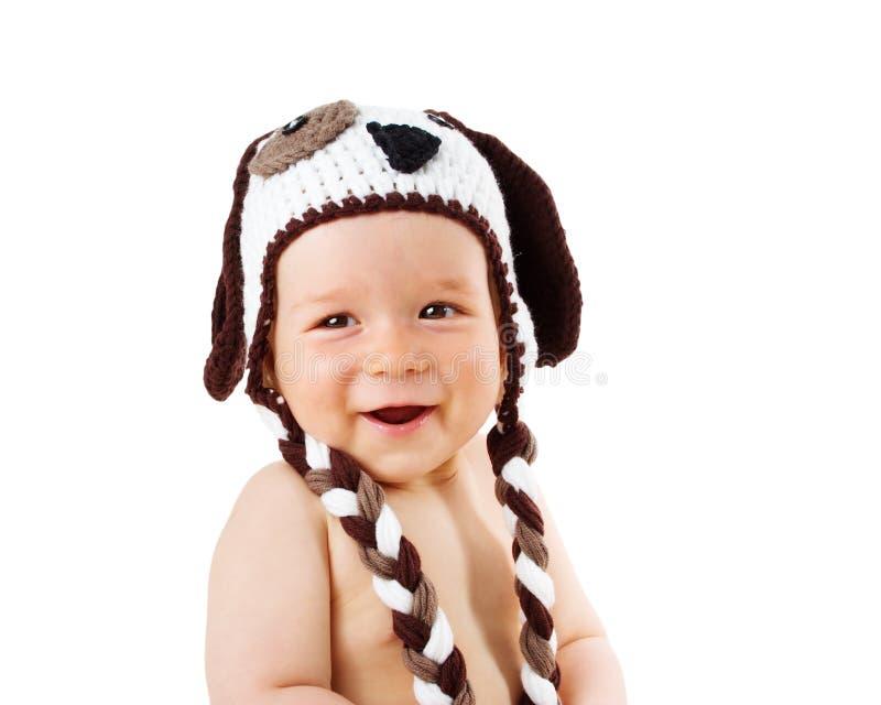 Dziecko w psi kapeluszowy ono uśmiecha się odizolowywam na bielu zdjęcie royalty free