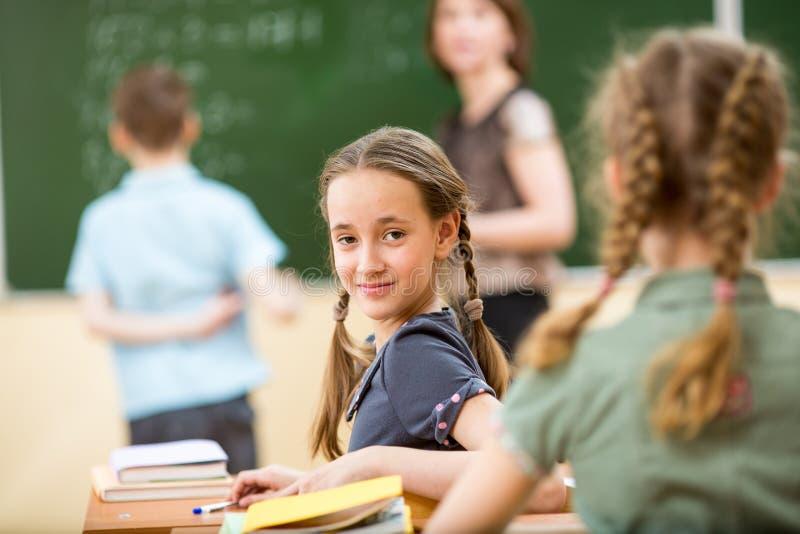 Dziecko w wieku szkolnym przy lekcją zdjęcia stock