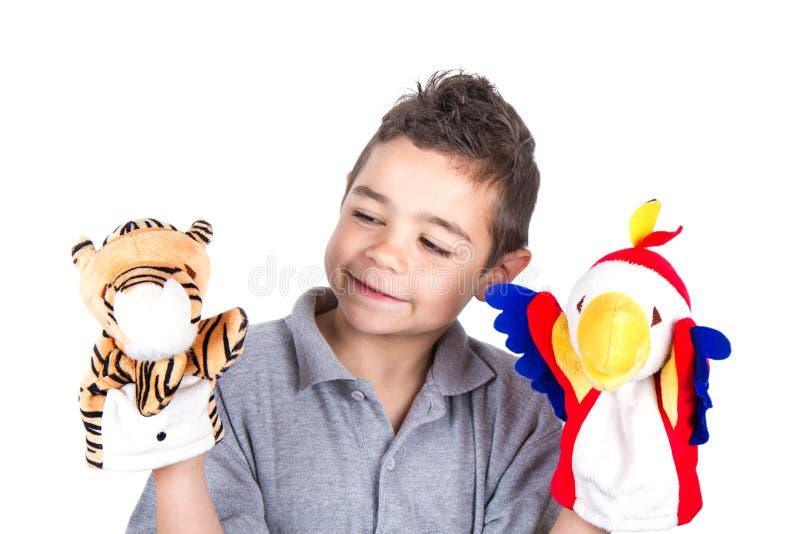 Dziecko z ręk kukłami obrazy stock