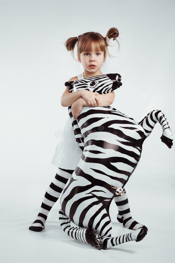 Dziecko z zebrą obrazy royalty free