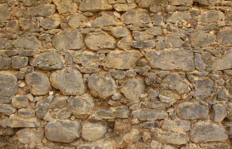 Dziejowa Nieociosana Kamiennej ściany tekstura zdjęcia royalty free