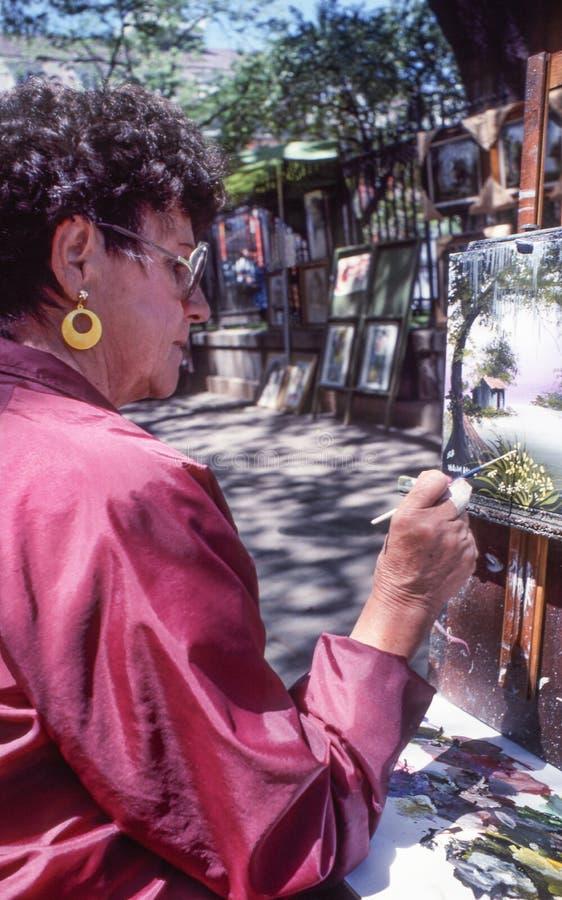 Dzielnica Francuska, Nowy Orlean, Około 2000-Woman artysty uliczny obraz na kanwie w Jackson kwadracie zdjęcia royalty free