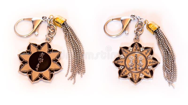 Dziesięć brzęczenia ochrony koła amuletu Kluczowy łańcuch fotografia royalty free