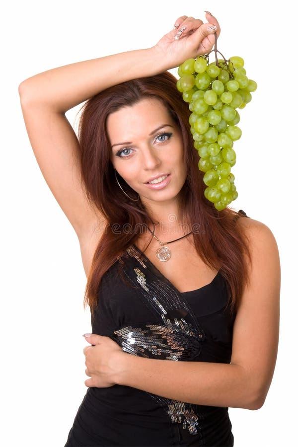 dziewczyn green winogron. zdjęcie royalty free