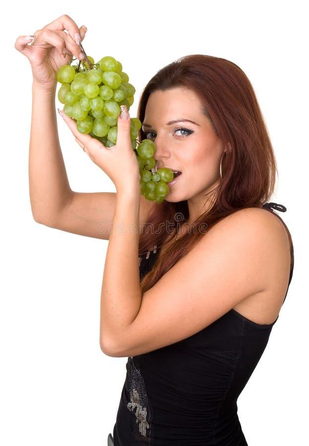 dziewczyn green winogron. zdjęcia royalty free