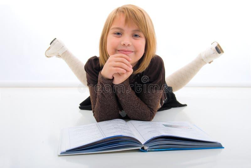 dziewczyn książkowi potomstwa fotografia royalty free