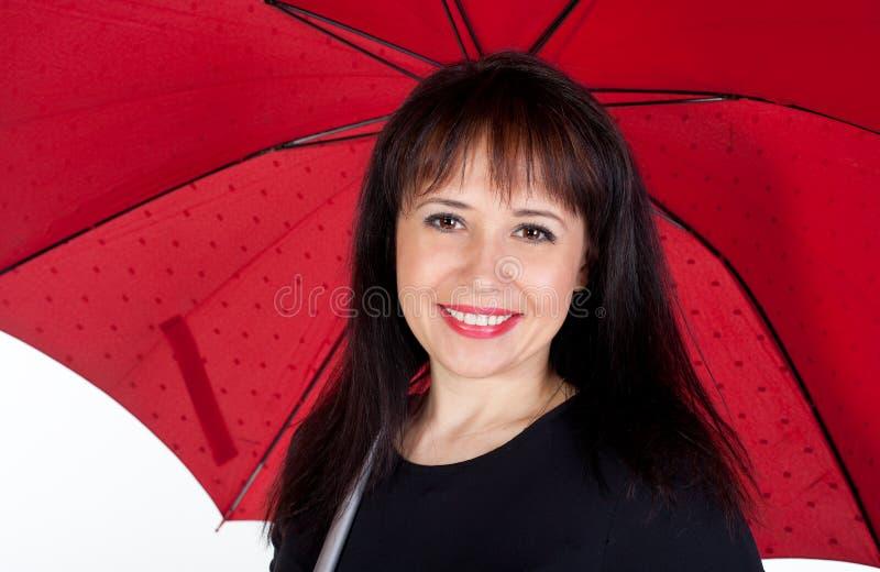 dziewczyn potomstwa czerwoni parasolowi zdjęcia royalty free