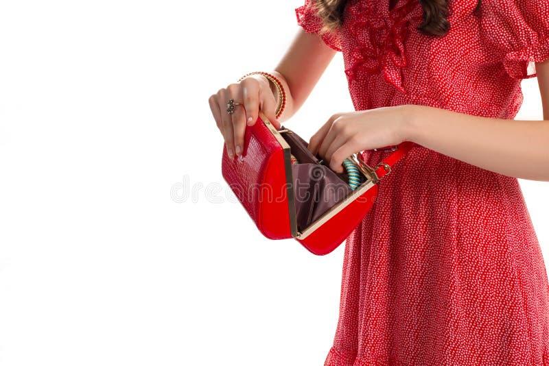 Dziewczyn ręki z czerwoną kiesą zdjęcia royalty free