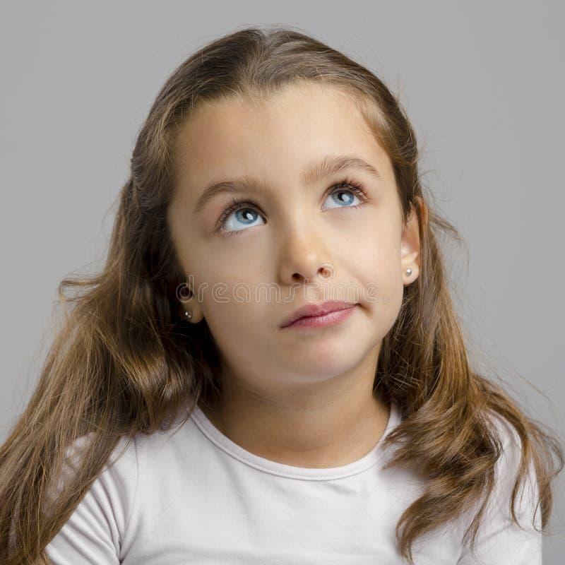 dziewczyna biel odosobniony myślący zdjęcie royalty free