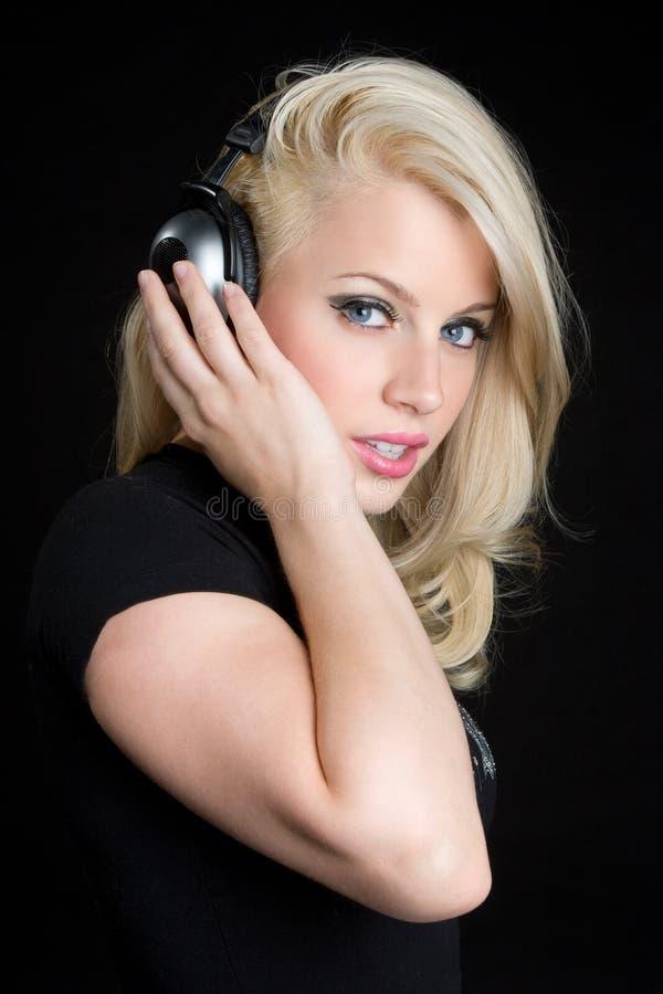 dziewczyna blond hełmofony obrazy royalty free