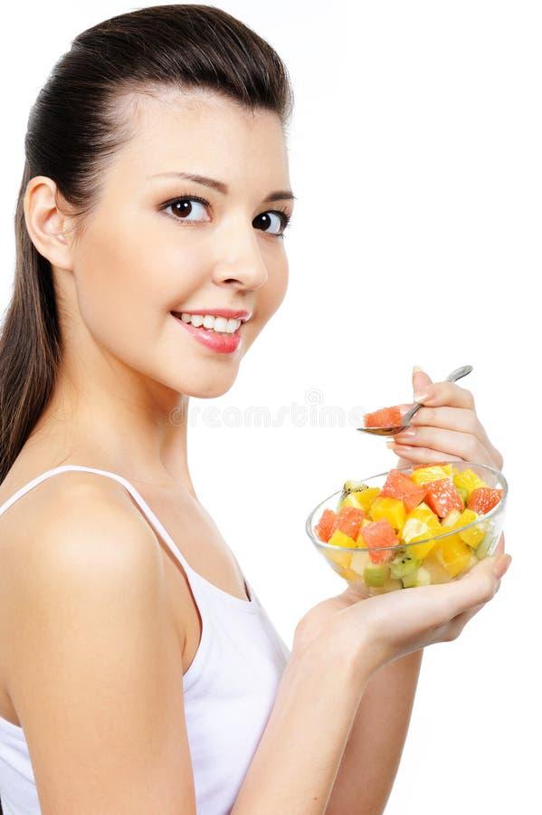 dziewczyna deserowa łasowania owoc dziewczyna fotografia stock