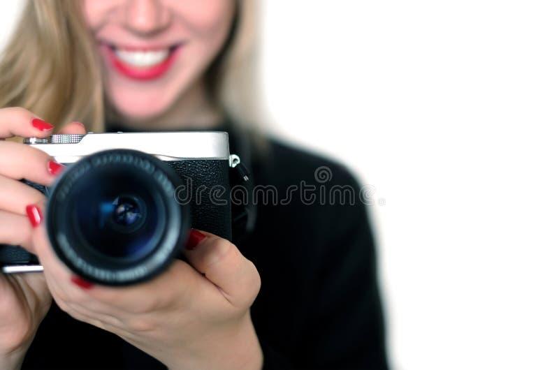 Dziewczyna fotografa uśmiech i robi obrazkowi zdjęcia stock