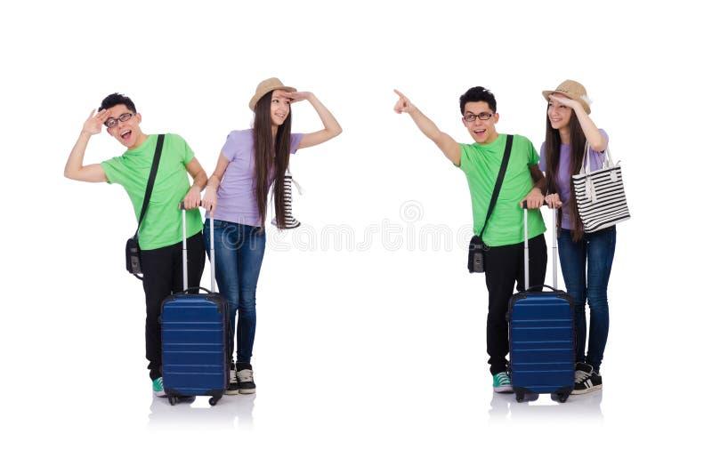 Dziewczyna i ch?opiec z walizk? odizolowywaj?c? na bielu zdjęcie royalty free