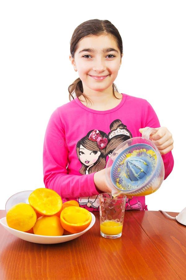 Dziewczyna i juicer zdjęcia stock