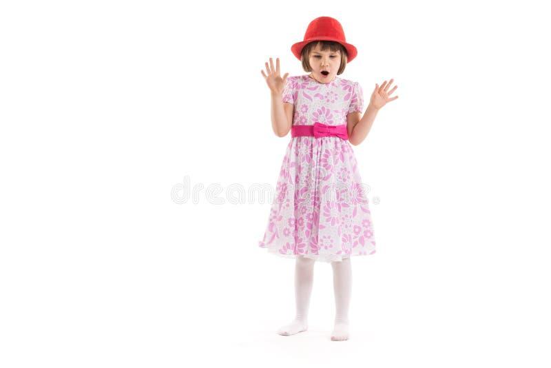 dziewczyna izolatów trochę zdziwiona white zdjęcia stock