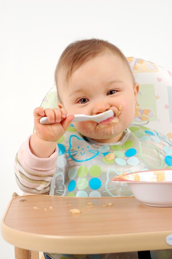dziewczyna jedzenie dziecka obraz royalty free