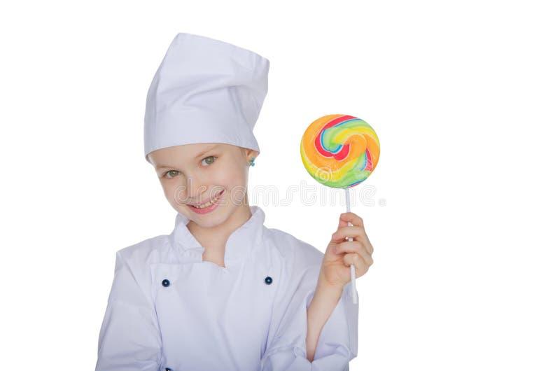 Dziewczyna kucharz z lizakiem obrazy stock