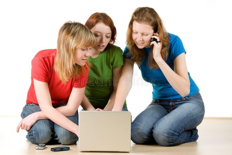 dziewczyna laptop trzy zdjęcie stock