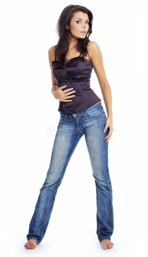 dziewczyna piękni błękitny cajgi zdjęcia stock