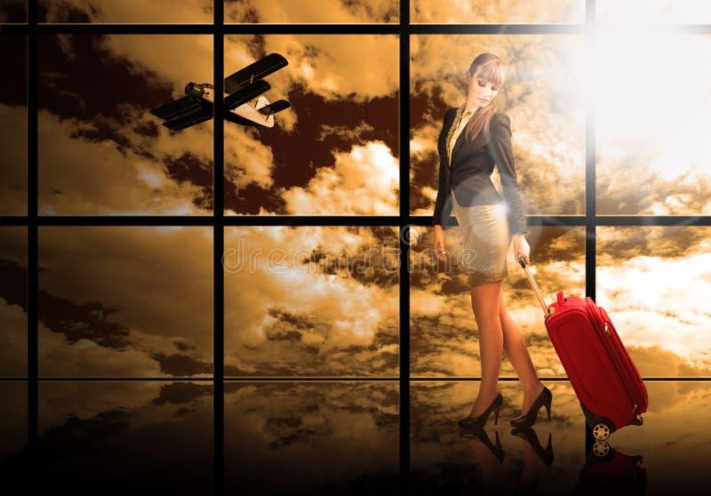 Dziewczyna przy lotniskowym okno fotografia royalty free