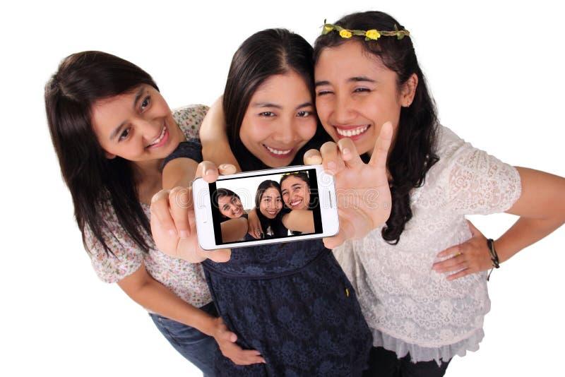 Dziewczyna przyjaciół selfie na telefonu ekranie odizolowywającym zdjęcie royalty free