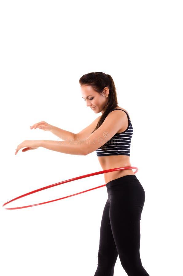 Dziewczyna robi hula obręczowi fotografia stock
