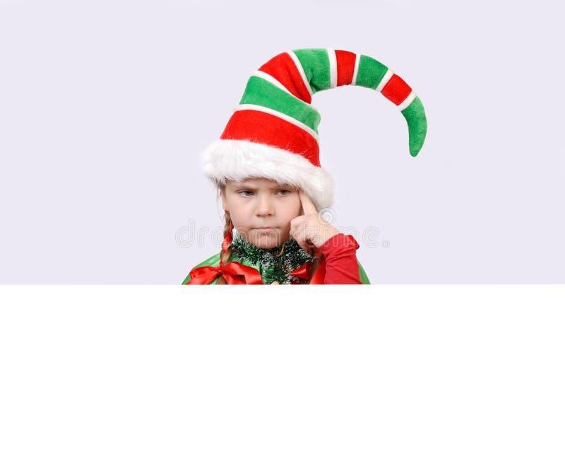 Dziewczyna - Santa elf z sztandarem fotografia stock