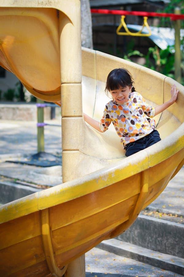 dziewczyna suwak mały bawić się zdjęcie stock