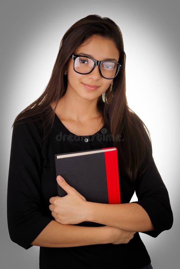 Dziewczyna Trzyma książkę Z szkłami obraz stock