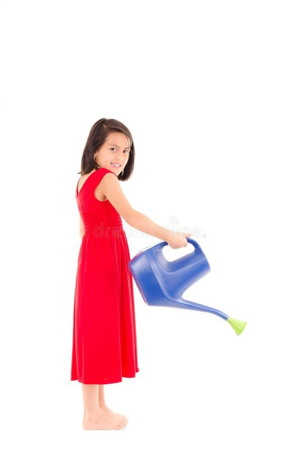 Dziewczyna trzyma podlewanie puszkę białą, Odizolowywający, zdjęcie royalty free