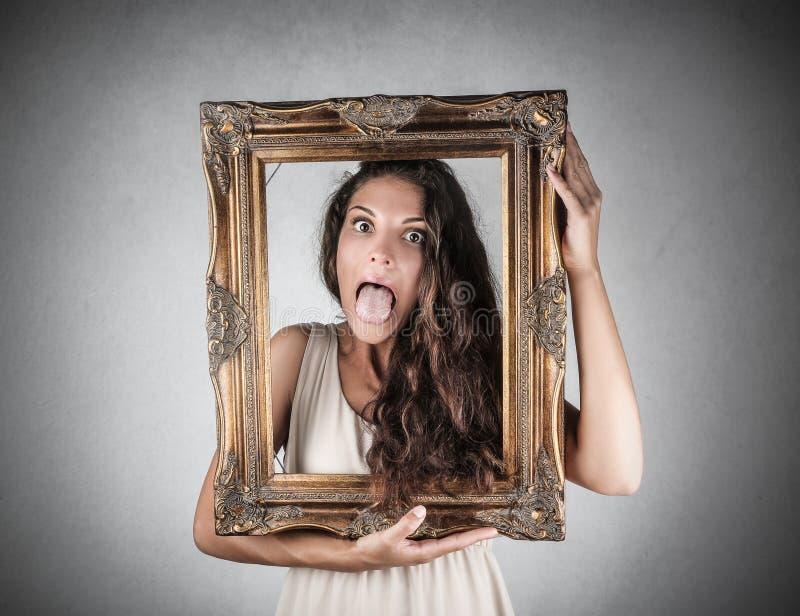 Dziewczyna trzyma ramę zdjęcie stock