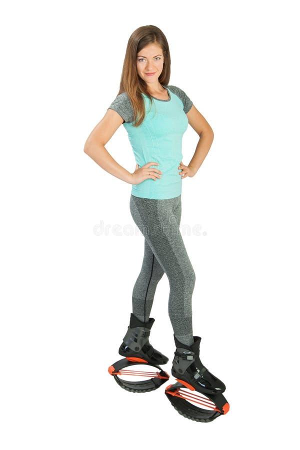 Dziewczyna ubierająca w kangoo skoków butach fotografia royalty free
