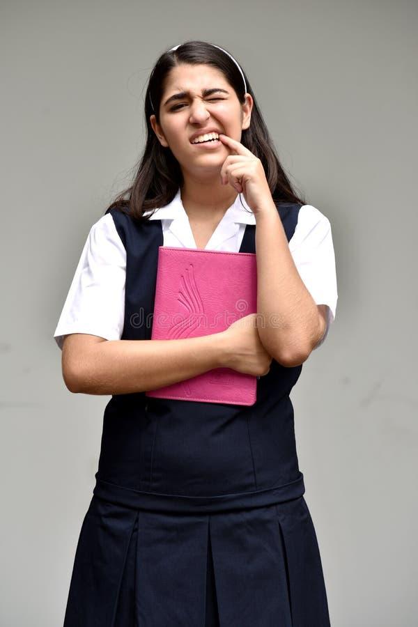 Dziewczyna uczeń Jest ubranym mundur Z Toothache obrazy royalty free