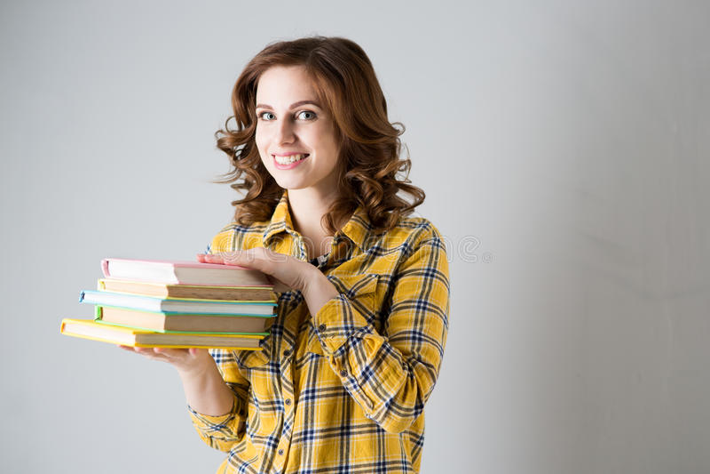 Dziewczyna uczeń z książkami fotografia royalty free