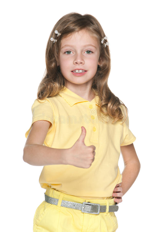 Dziewczyna w żółtej bluzce z jej kciukiem up zdjęcia royalty free
