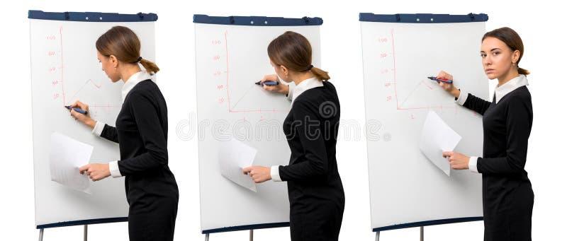 Dziewczyna w biurze rysuje grafika obrazy stock