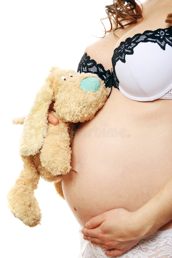 dziewczyna w ciąży jej brzuch wskazujący zdjęcia royalty free