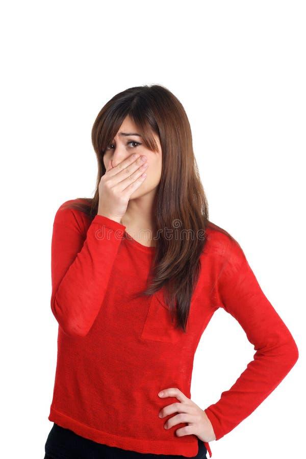 Dziewczyna w czerwieni z zaśmierdłym gestem fotografia royalty free