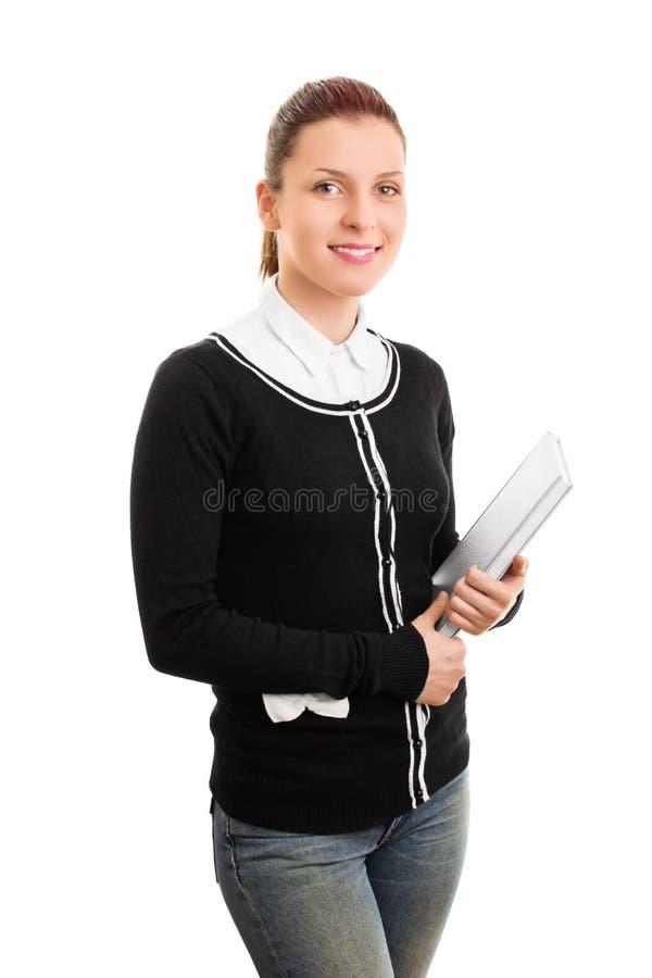 Dziewczyna w jednolitych mienie książkach zdjęcie royalty free