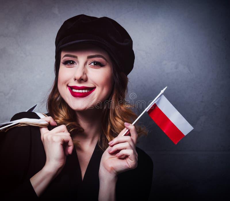 Dziewczyna w kapeluszu z torba na zakupy i flaga Polska fotografia stock