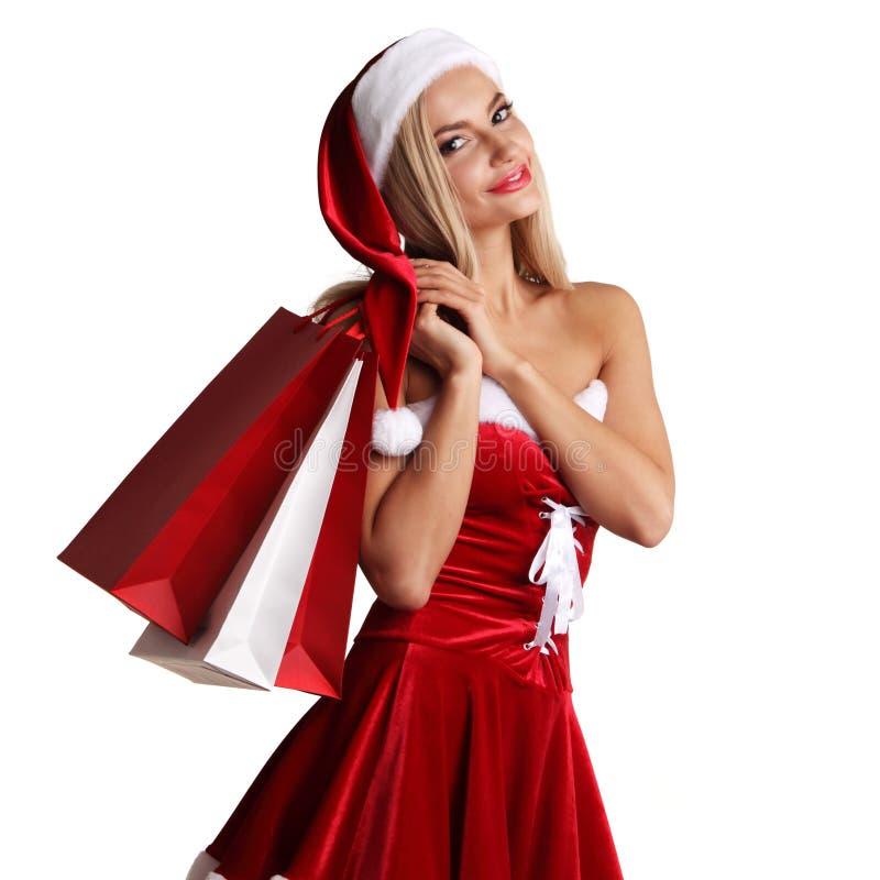 Dziewczyna w Santa Claus kostiumowym zakupy zdjęcia stock
