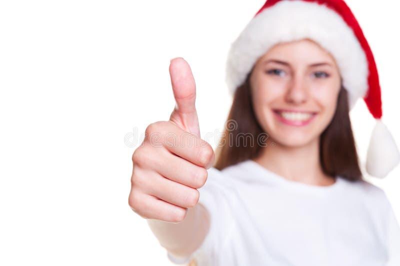 Dziewczyna w Santa kapeluszu pokazywać aprobaty obrazy stock