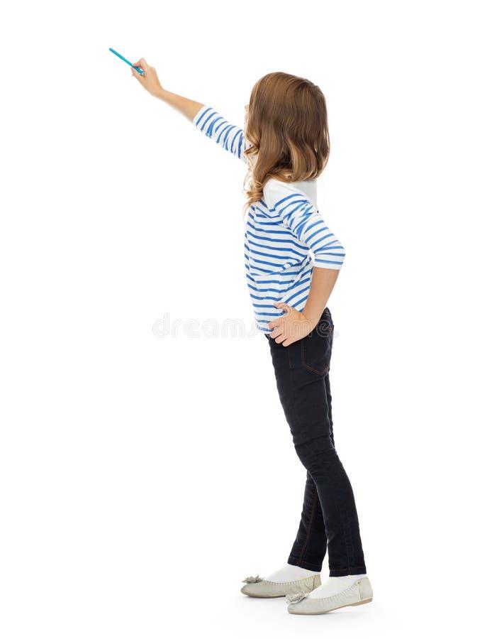 Dziewczyna wskazuje markiera przy coś niewidzialnym obraz stock