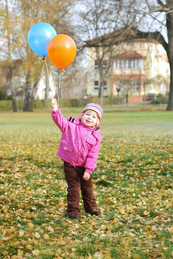 Dziewczyna z balonami obraz stock