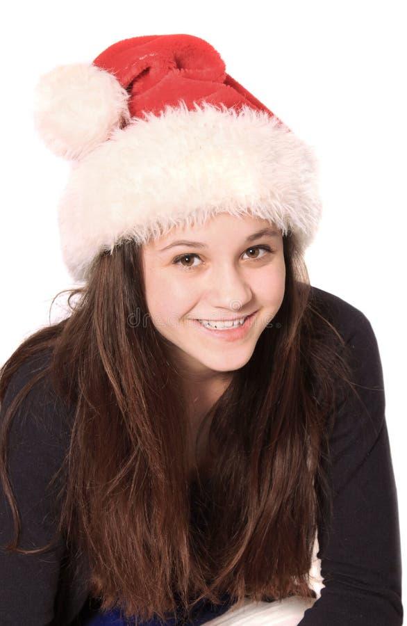 Dziewczyna z bożymi narodzeniami kapeluszowymi fotografia royalty free