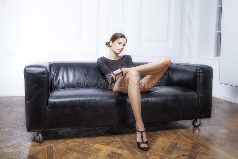 Dziewczyna z długimi noga skutka filmami zdjęcia stock