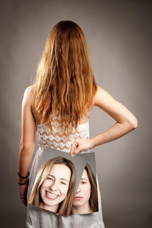 Dziewczyna z dwa twarzami zdjęcia stock